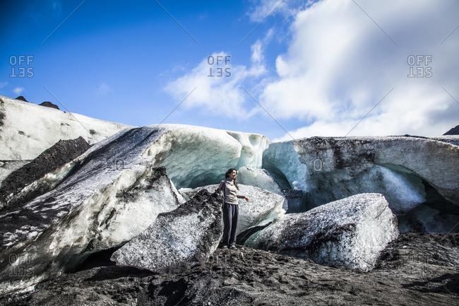 Reykjavik, Iceland - October 23, 2008: Woman having her photograph taken at a glacier in Reykjavik, Iceland