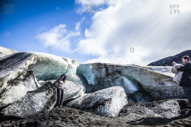 Reykjavik, Iceland - October 23, 2008: Couple photographing each other at a glacier in Reykjavik, Iceland