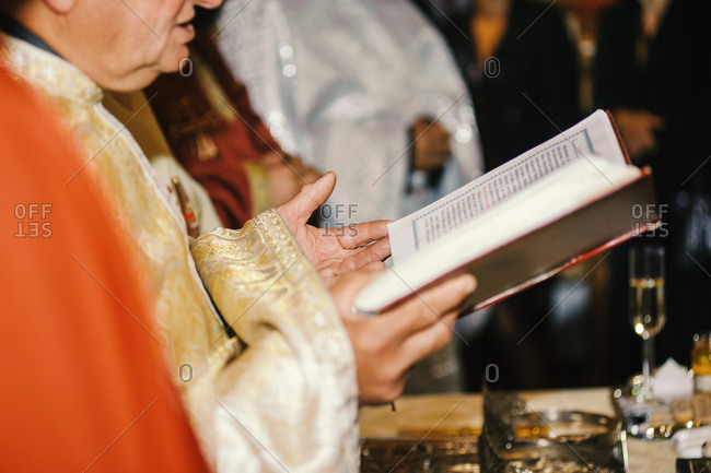 Priest reading from Bible in a church