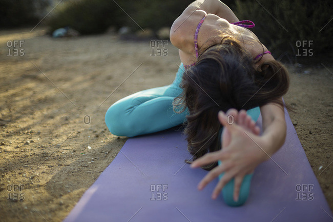 Close up of woman stretching