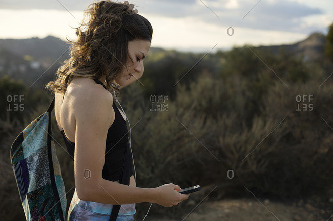 Woman using device with headphones