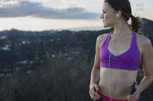 Athletic woman listening to earbuds