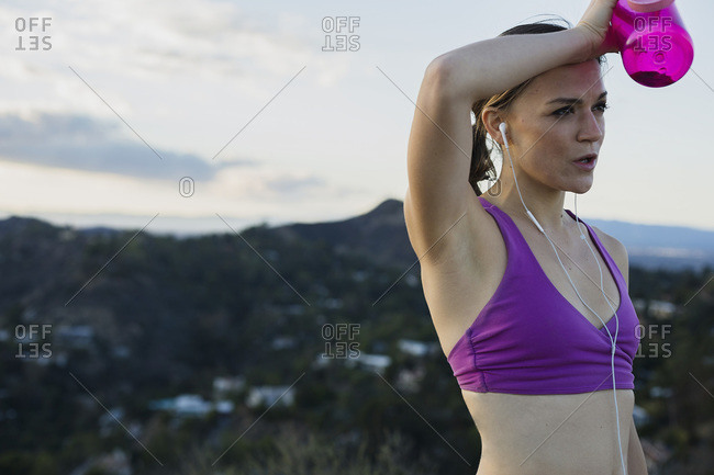 Athletic woman wiping her brow
