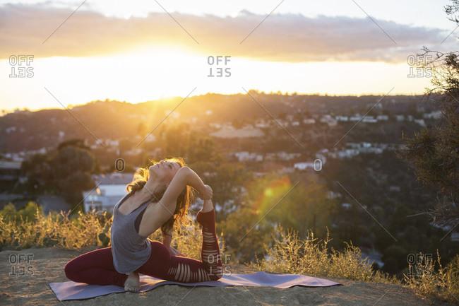 Woman on hill doing yoga