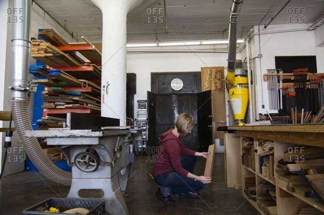 Woman choosing board in workshop