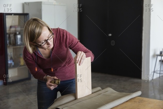 Woman using planning tool on board