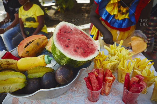 A Colombian woman chops fruit in Cartagena