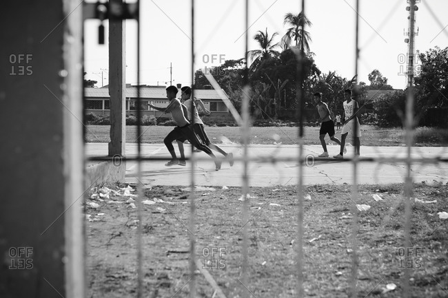 Teenagers playing soccer in Mompox, Colombia