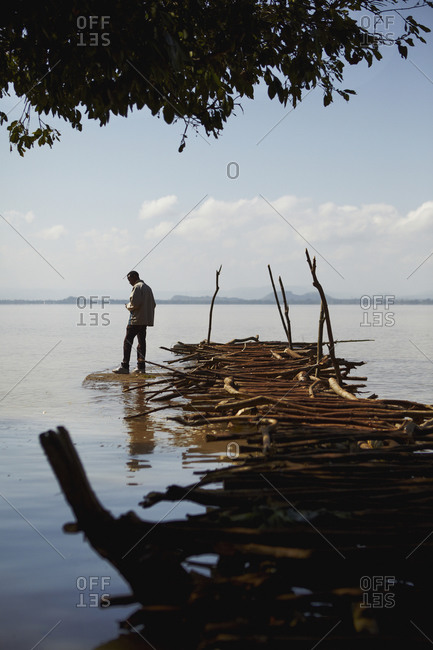 A man on rustic pier in Ethiopia