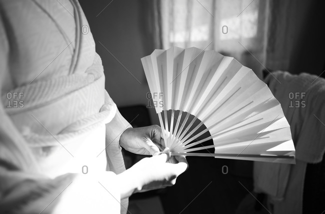 A Japanese bride holding her wedding fan stock photo - OFFSET