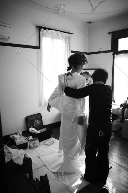 A Japanese bride dresses for her wedding