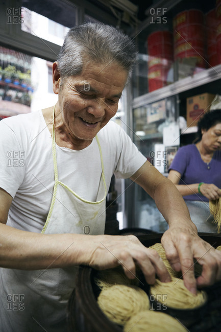 Man making noodles in Macao, China