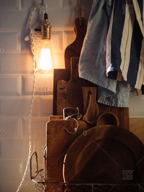 Close-up of wood cutting boards and linen towels in a kitchen