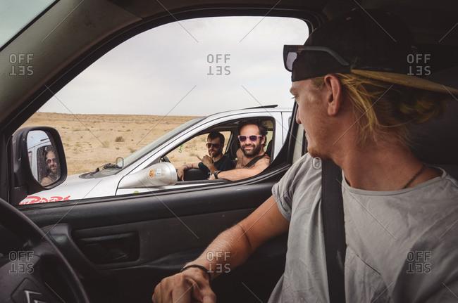 Turkmenistan - August 3, 2014: Passenger watching men in second car