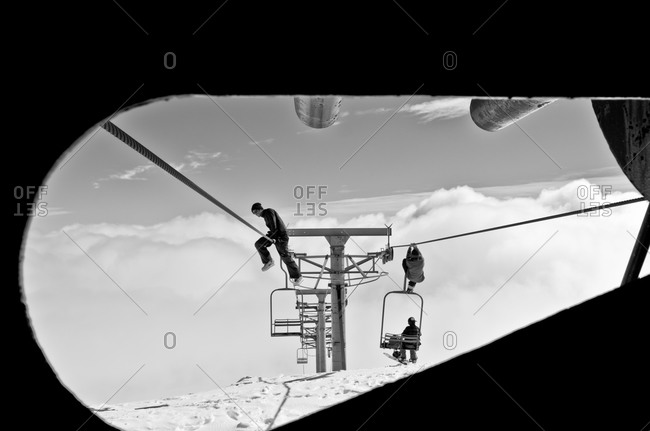 Las Condes, Chile - August 29, 2012: Men climbing on ski lift