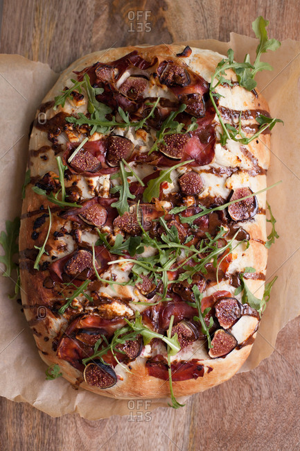 Flatbread pizza with vegetables and greens