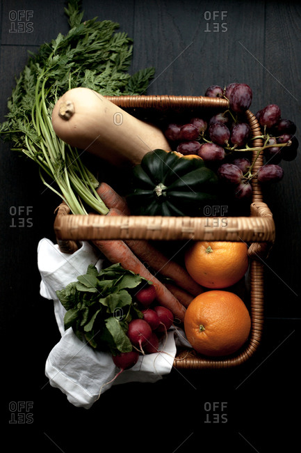 Overhead view of a basket filled with fruits and vegetables