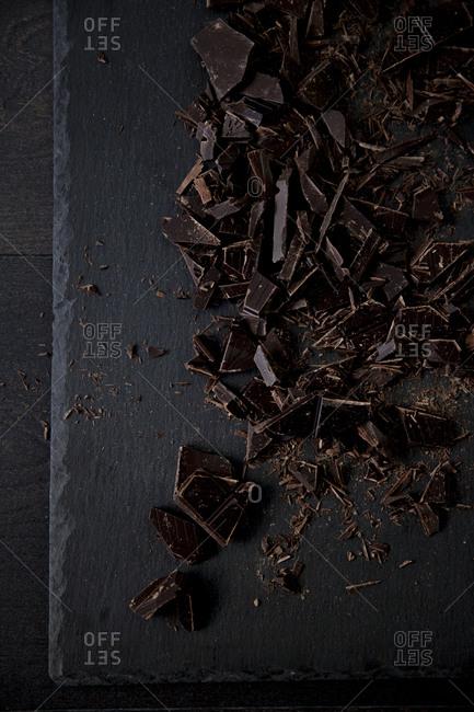 Chunks of baking chocolate on a cutting board