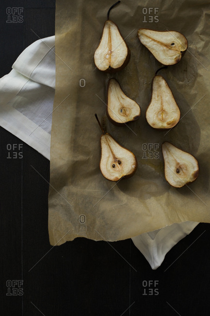 Sliced pears on a baking sheet lined with parchment paper