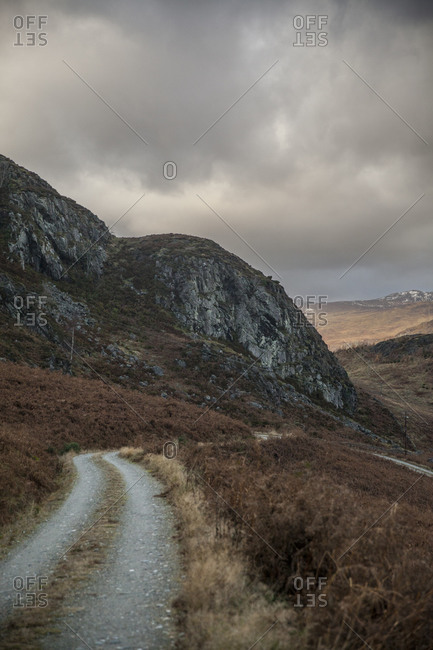 Winding gravel road in the mountains of Scotland
