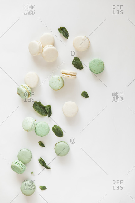 Green and white pastel macaroons with mint leaves