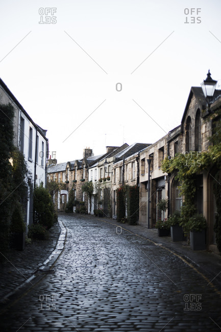 Winding cobblestone street in a Scottish neighborhood
