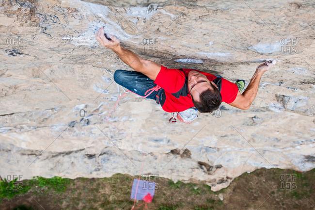 Overhead view of rock climber ascending Gin and Tonic 5.13b, White Mountain, Yangshuo, Guangxi Zhuang, China