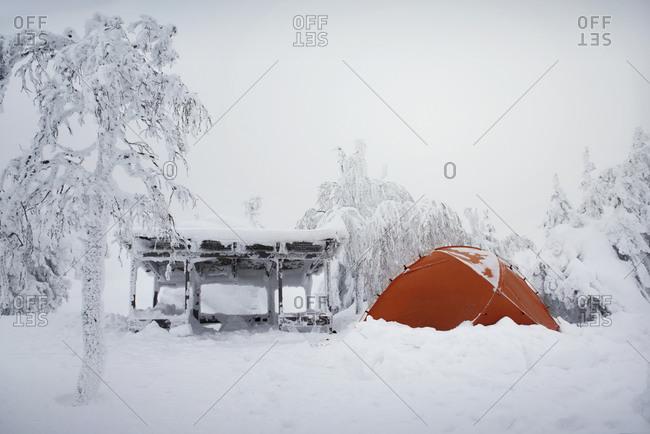 Orange tent setup in the winter
