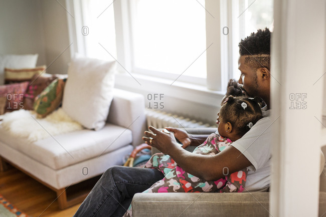 Father and his kids playing on a tablet together