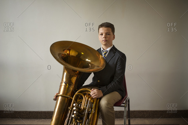 Portrait of a boy and his tuba