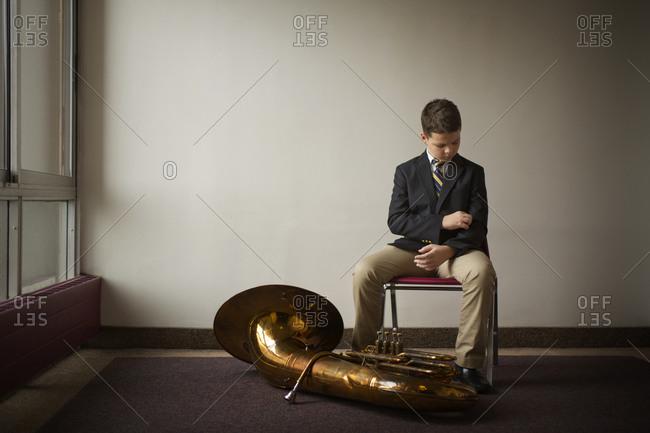 Boy preparing to play his tuba