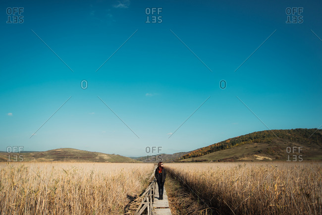 Woman on wood path in countryside