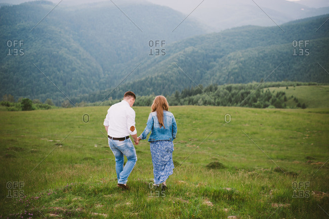 Couple strolling in the country
