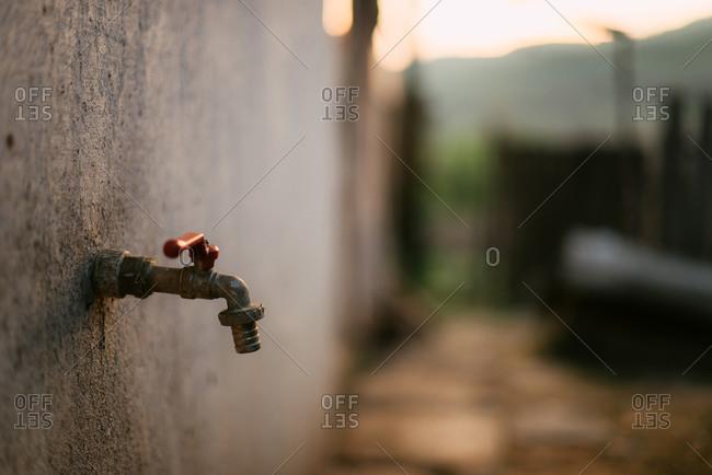Outdoor water spigot on building