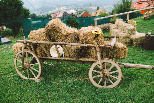 Wagon with hay bales on hilltop