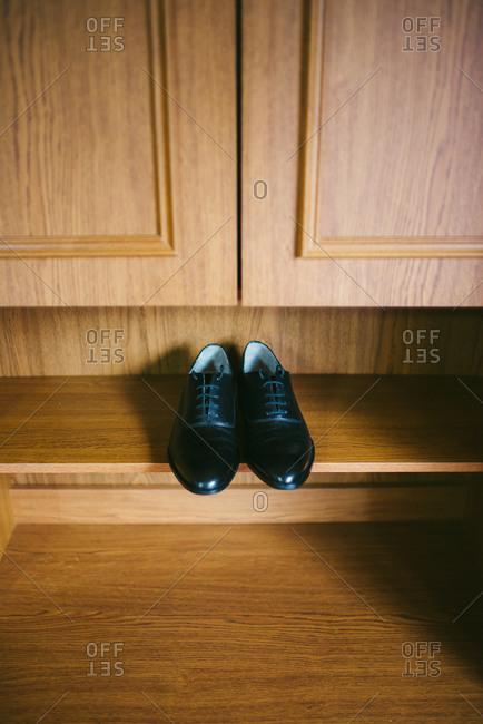 Men's dress shoes on shelf