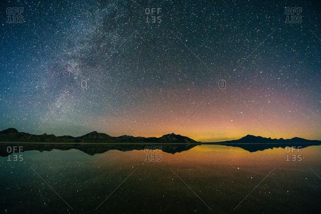 Reflecting pool of mountain range and Milky Way at dusk, Bonneville, Utah, USA