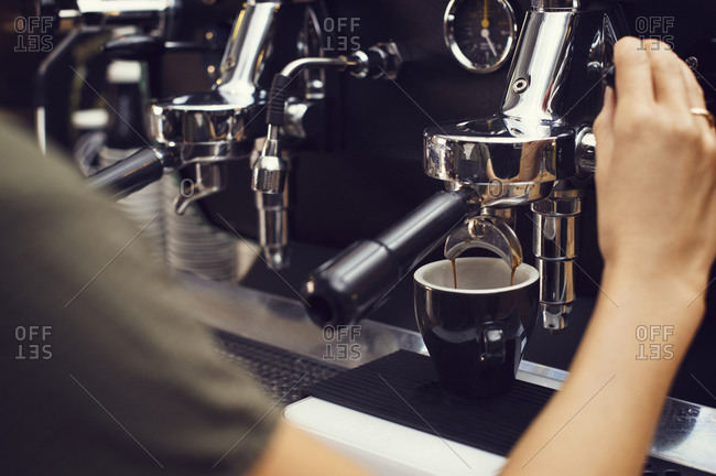 Close-up of a woman making an espresso