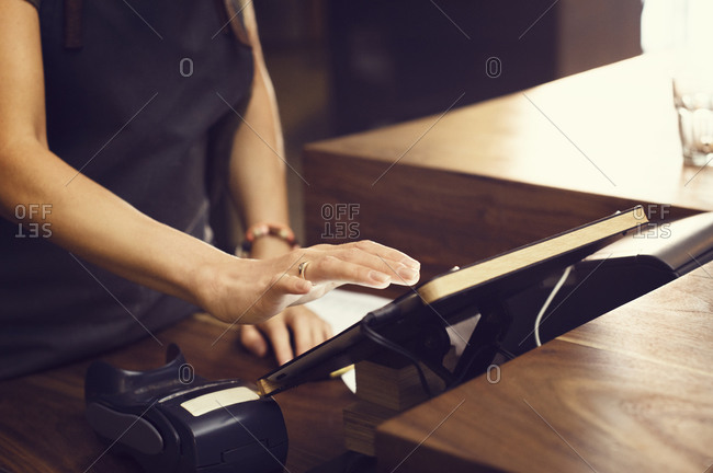 Woman using a digital tablet for a business transaction