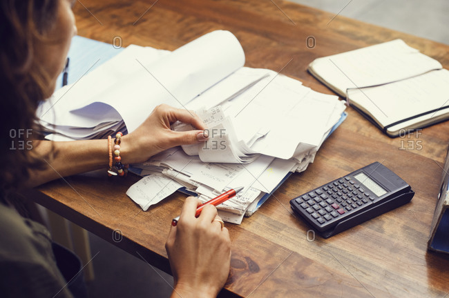 Closeup of woman reviewing business files