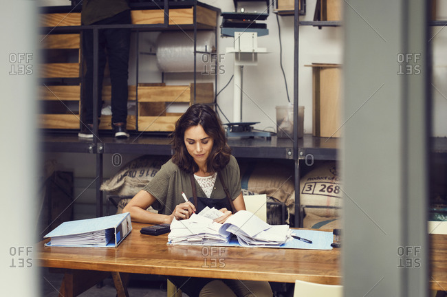 Woman going over business files in her office