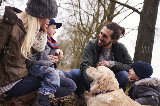 Family together with dog on winter walk