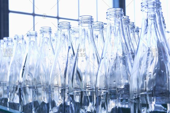 Empty blue bottles in bottling plant
