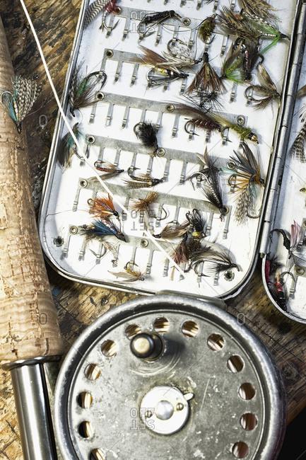 High angle view of fishing rod and baits on table