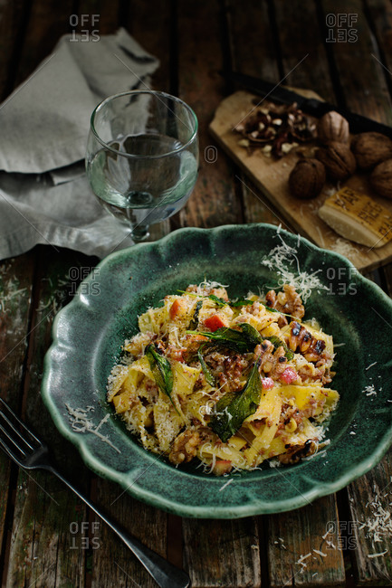 Pasta dish with walnuts, apples, fried sage, parmesan
