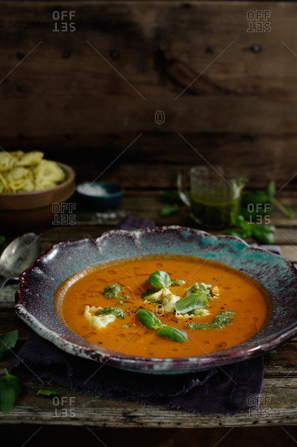 Tomato soup with cheese tortellini and basil pesto