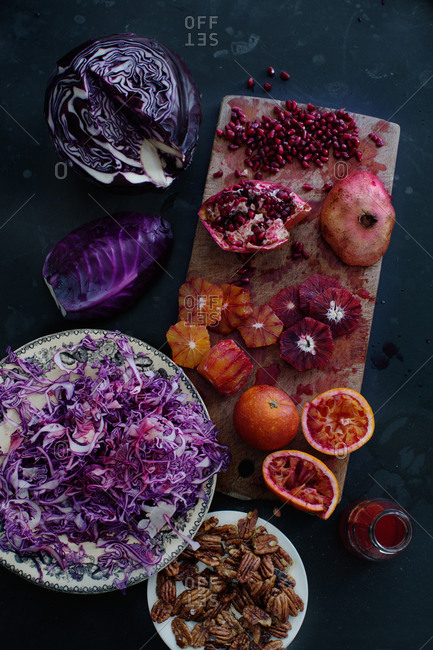 A variety of ingredients including red cabbage, blood oranges, pomegranate, and pecans