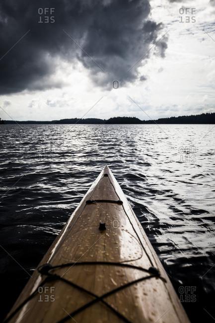Kayak on lake against cloudy sky at dusk