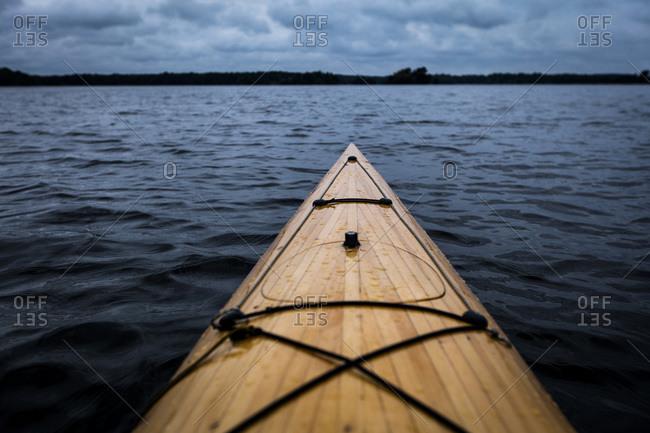 Kayak on lake at dusk