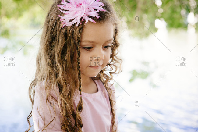 Girl outside with flower in hair
